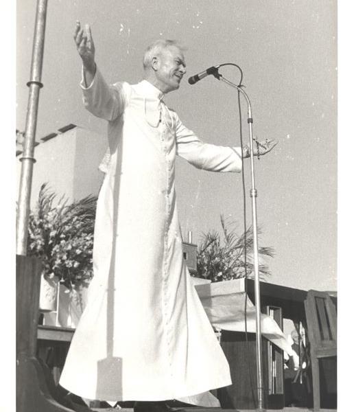 Fr Peyton prays wearing white cassock